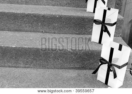 Pretty gift bags on cement steps