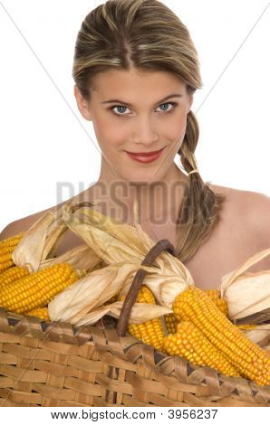 Smiling Girl Holding A Basket Filled With Corn