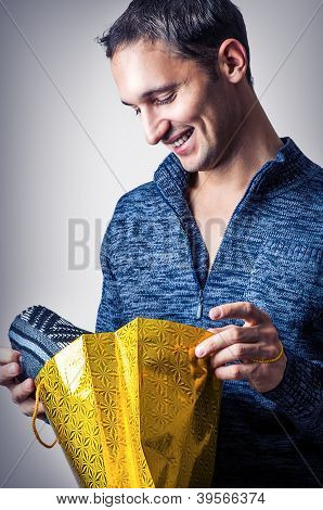 Happy Man Holding Textile Gift
