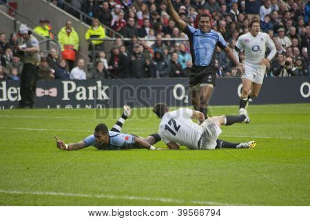 TWICKENHAM LONDON - NOVEMBER 10: Nikola Matawalu scores a try for Fiji at England vs Fiji, England playing in white Win 54-12, at QBE Rugby Match on November 10, 2012 in Twickenham, England.