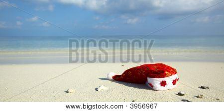 Christmas Hat On A Beach