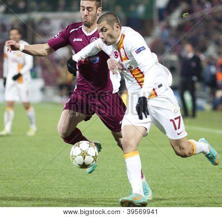CLUJ-NAPOCA, ROMANIA - NOVEMBER 7:  Ivo Pinto and Burak Yilmaz in UEFA Champions League match between CFR 1907 Cluj vs Galatasaray,  on 7 Nov., 2012 in Cluj-Napoca, Romania