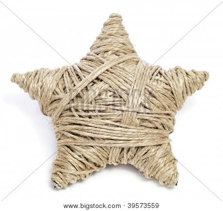 a christmas star made with hemp twine on a white background
