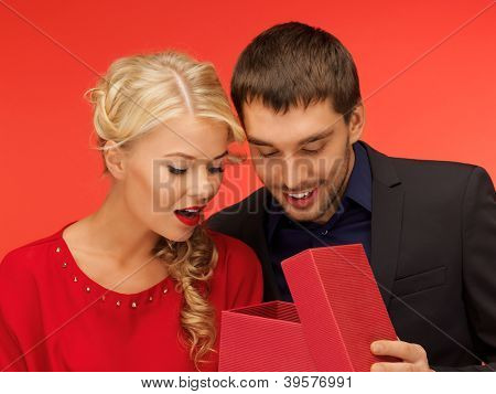 picture of man and woman looking inside the box (focus on man)