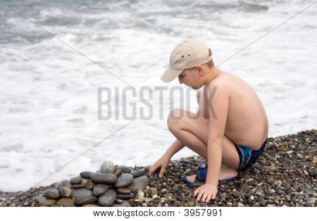 Boy Play With Pebbles