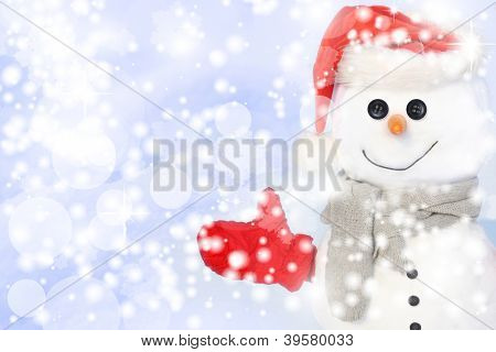 Snowman against snowy field.