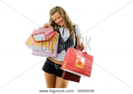 Happy Young Woman Holding Bags And Smile