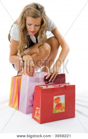 Happy Young Woman Looking At The Bags