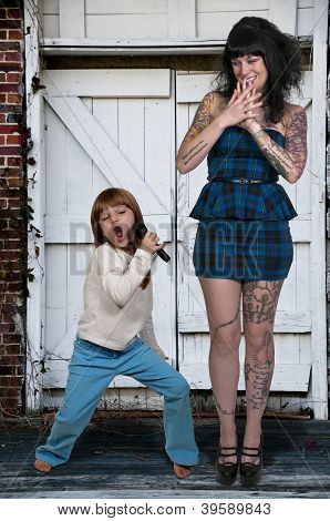 Beautiful Tattooed Woman And Her Daughter