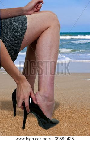 Beautiful Woman Taking Off Shoes