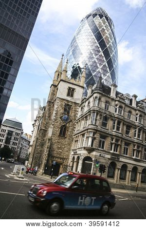 London Taxi Cab Driving Past Gherkin