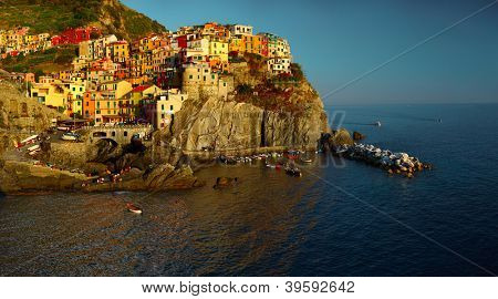 Panorama of Manarola town of Cinque Terre National Park at calm sunny day, Italy