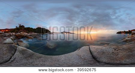 Spherical, 360 degrees panorama of a rocky coast of Andaman sea near Laem Sing beach at sunset. Phuket, Thailand
