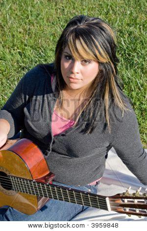 Girl Playing A Guitar