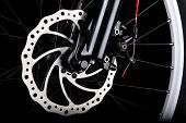 stock photo of mountain chain  - Front disc brake on mountain bike studio shot on black background - JPG