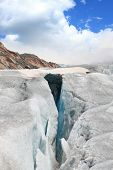 stock photo of crevasse  - large crevasses with a snow bridge - JPG