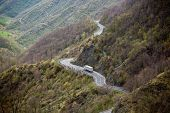picture of long winding road  - Long Winding Road Through Italian Mountains Landscape - JPG