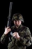 foto of m16  - Soldier reloading magazine of m16 in studio - JPG
