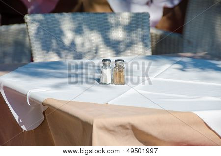 Restaurant Table With Salt And Pepper