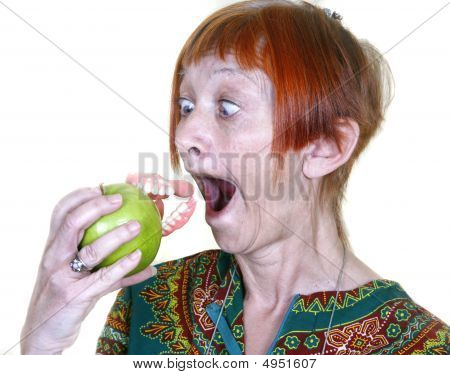Woman Eating Apple False Teeth Denture