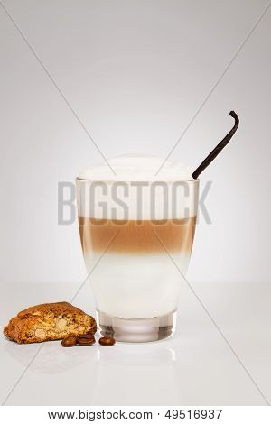 Small Latte Macchiato With A Vanilla Bean And A Cookie