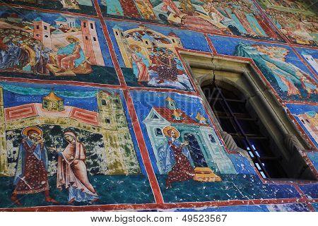 Painted wall at Arbore monastery, Bucovina, Romania