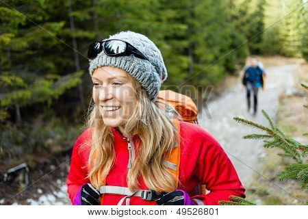 Couple Hikers Hiking In Forest
