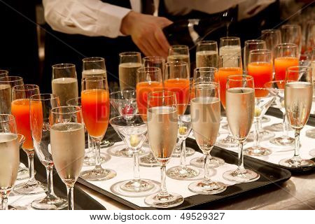 Row Of Glasses Filled With Champagne Lined Up Ready To Be Served