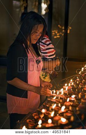 Lighting Devotional Candles