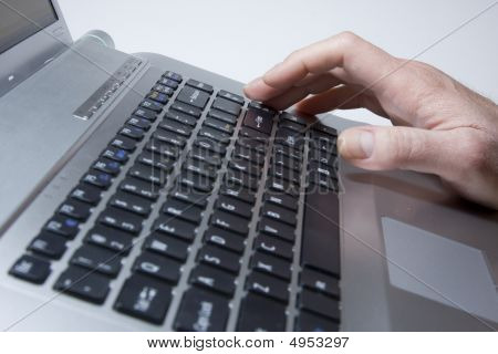 Male Hands Typing On A Laptop.