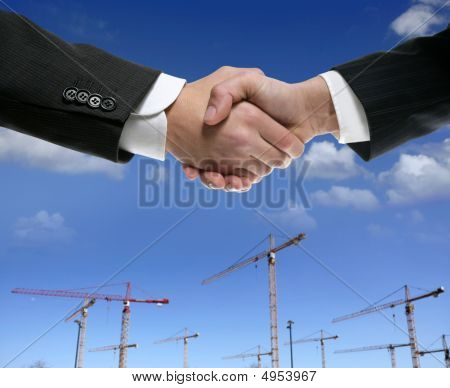 Businessmn Handshake In Construction Area