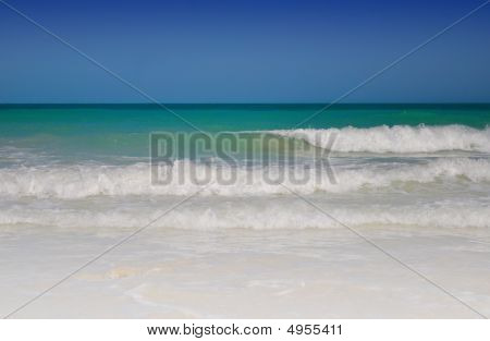 White Beach With Waves