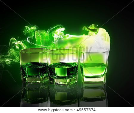 Three glasses of green absinth