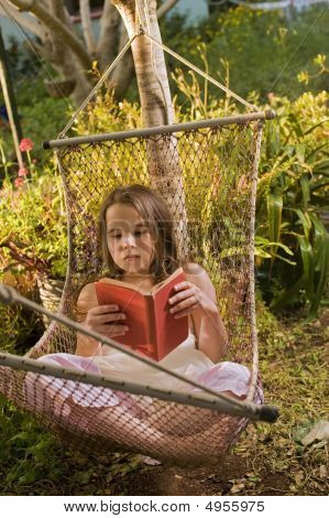 Girl In Hammock Reading