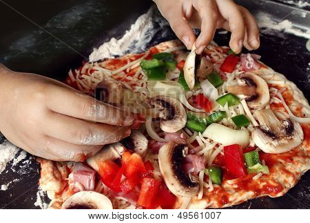 Child Preparing Pizza