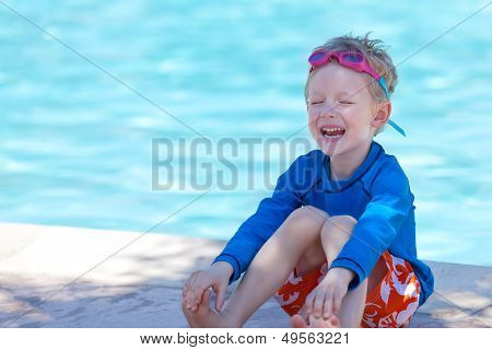 Kid By The Swimming Pool
