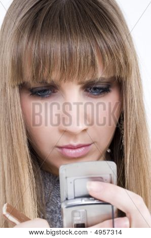 Pretty Female Model With Cellphone And Chocolate