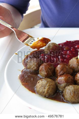 Food Being Eaten. Dinner Meatballs With Potatoes.