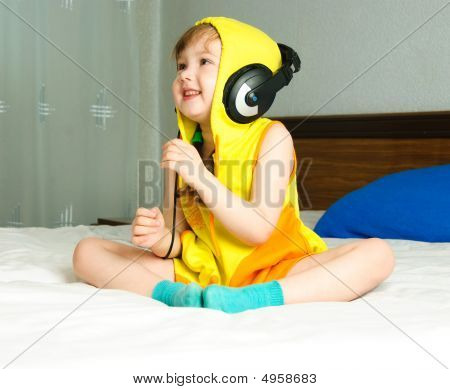 Little Girl Listening To The Music
