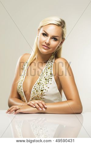 An Attractive Blonde Woman Looking At The Camera