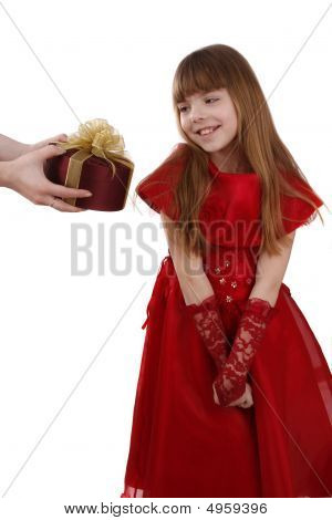 Surprise. Little Girl Is Getting Gift. Girl Feels Shy.