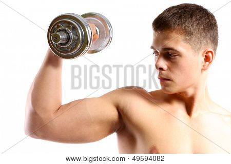 Handsome young muscular sportsman execute exercise with dumbbell, isolated on white