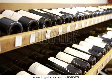 Wine Bottles Displayed On Rack In Wine Shop