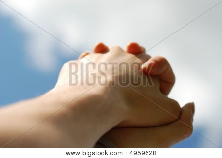 Two Hands And Blue Sky