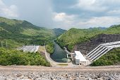foto of hydro-electric  - Large hydro electric dam in Thailand taken on a cloudy day - JPG