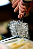 stock photo of bartender  - close up photo of a bartender pouring a few drinks at a bar