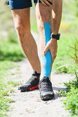 Man Running With Kinesiotape