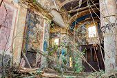 foto of church interior  - interior of an abandoned and dilapidated church with rubble and debris  - JPG
