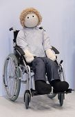 stock photo of rag-doll  - A Full Size Rag Doll Model in a Manual Wheelchair - JPG