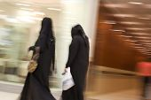 picture of hijab  - Dubai UAE Two women dressed in traditional abayas and hijabs black robes and scarves - JPG